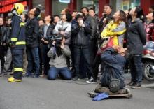 หนุ่มจีนขาพิการตะโกนเกลี้ยกล่อมชายคิดสั้นไม่ให้โดดตึก
