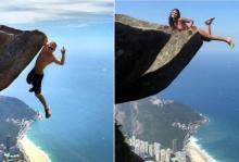 เผยภาพสุดหวาดเสียว! คู่รักท้ามฤตยูโหนตัวขอบหน้าผาสูงเกือบ 900 เมตร