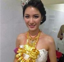 ฮือฮา เจ้าสาวลูกเศรษฐีจัดเต็มทองคำทั้งตัว 5 กก
