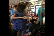 ดราม่า!! แม่ป้อนข้าวลูกบนรถไฟฟ้า เจอชาวเน็ต ถ่ายรูปประจาน ข้อหาไม่เคารพกฎ