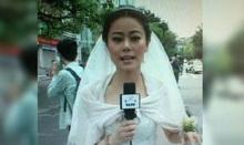 สปิริตแรง นักข่าวสาวจีนรายงานข่าวทั้งชุดเจ้าสาว